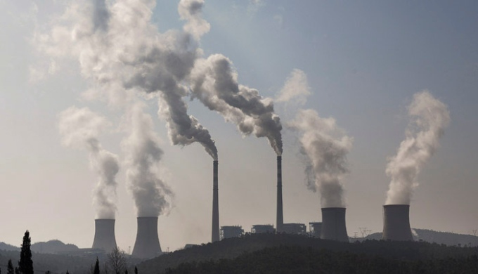 A potential shift in China's position toward emission caps will be tectonic. Picture shows the chimneys from a coal-burning power station in China. (Image by Mingjia Zhou)