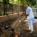 Narendra Modi cleaning the premises of Mandir Marg Police Station during his surprise visit to check on cleanliness in New Delhi (Image by Press Information Bureau, Government of India)
