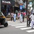 Pedestrians cross a busy road in Thrissur (Image by S. Gopikrishna Warrier)