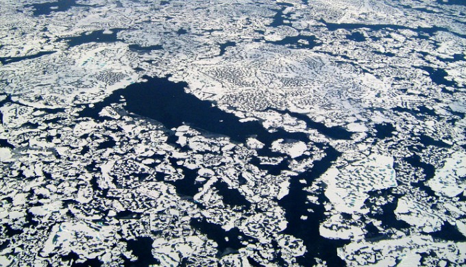 Methane leaking through the cracks of melting permafrost in the Arctic (NASA's Earth Observatory)