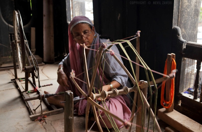 A woman spinning a traditional 'charkha' or a spinning wheel (Image by Nevil Zaveri)