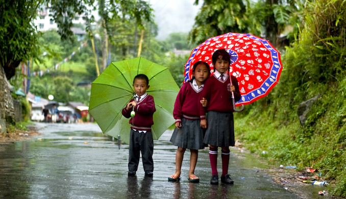Children walking in the rain in Sikkim. (image by Marina Shakleina)