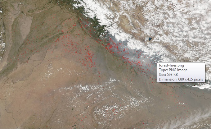 Fires dot the landscape on the border of India (right) and Pakistan (left) at the foothills of the Himalaya Mountains. (Courtesy: NASA)