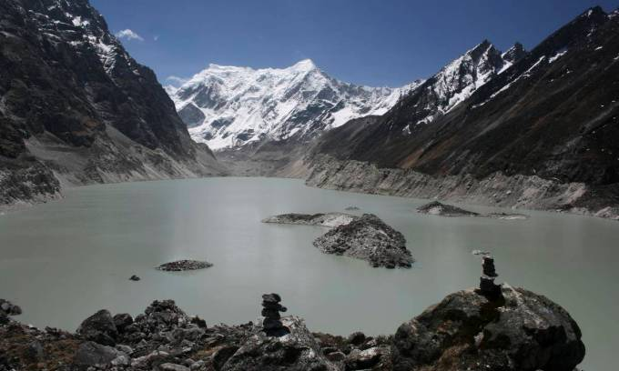 Tsho Rolpa Glacial Lake: an example of the potential threat behind the beautiful glacial lakes in the Rolwalling valley, Nepal. Tsho Rolpa is one of the high priority potentially dangerous glacial lakes in the Nepal Himalayas. As a result of climate change and fast retreat of the glacier, the lake expanded from 0.23 square kilometres to 1.53 square kilometres between 1960 and 2010, according to Pradeep Mool of ICIMOD. The fast retreating glaciers and adjoining glacial lakes increase the threats of glacial lake outburst flood (GLOF). GLOFs most likely would cause extensive damage to people and property downstream. This image was taken on May 10, 2010 (Photo by Nabin Baral)