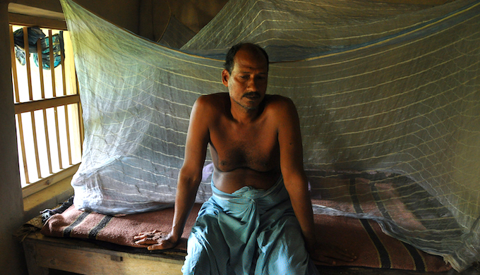 "Nilmani Parua, in his forties, lives alone in his two-roomed hut. Parua would have been a sought after groom anywhere in West Bengal but not in Ghoramara. Climate change has wrought a curious social upheaval. Anywhere else it's easier to get the boys married but in Ghoramara they struggle to get a wife unless she is from the same island. ""Who will get his daughter married off in a family which lives in sinking island such as Ghoramara,"" Parua says ruefully, sitting in his bachelor's den."