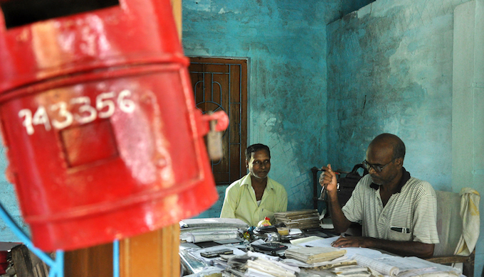 "The post office in Ghoramara was only second to be set up in West Bengal after Kolkata. Once a two-storied building on 36 acres of land, it is now reduced to a rented single room of 80 square feet. ""Everything went under the water about 12 years ago and since then we have been working in this rented place,"" says postman Abhimonyu Mondal. Now the post office closes around midday because there is very little work. ""In average, 10 to 12 letters come every day. How much time do you need to dispatch them?"" asked postmaster Srikanto Rana."