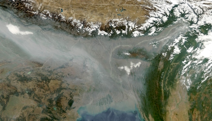 A satellite image shows haze pollution hugging the Himalayas. (Photo by NASA)