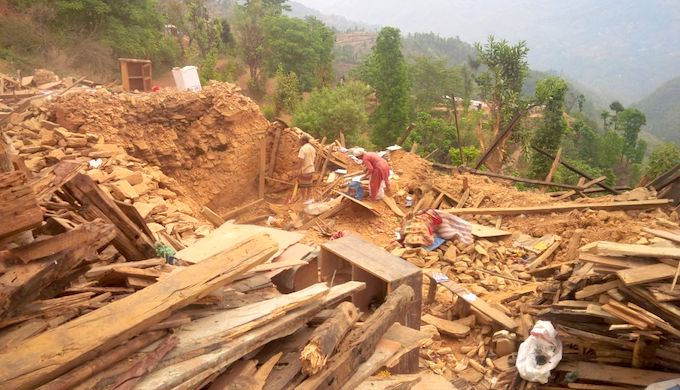 Nepal earthquake survivors in 2015 salvage what they can from the rubble. (Photo by UN Migration Agency)