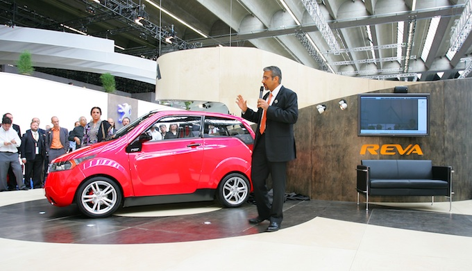 Chetan Maini introducing a model of the Reva electric car at the Frankfurt Motor Show. (Photo by Reva Norge)