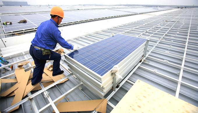 Solar roof installation in Shanghai, China. (Photo by Jiri Rezac)