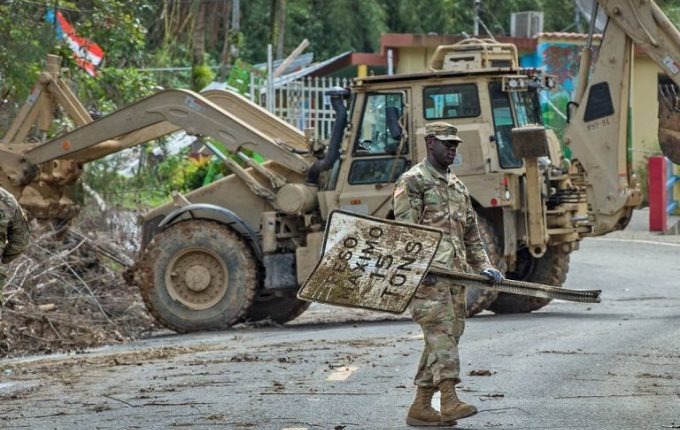 PFC Raiquan Wade, of the South Carolina National Guard, clearing debris in Puerto Rico after Hurricane Maria [image by: The National Guard/SSG Mark Scovell]