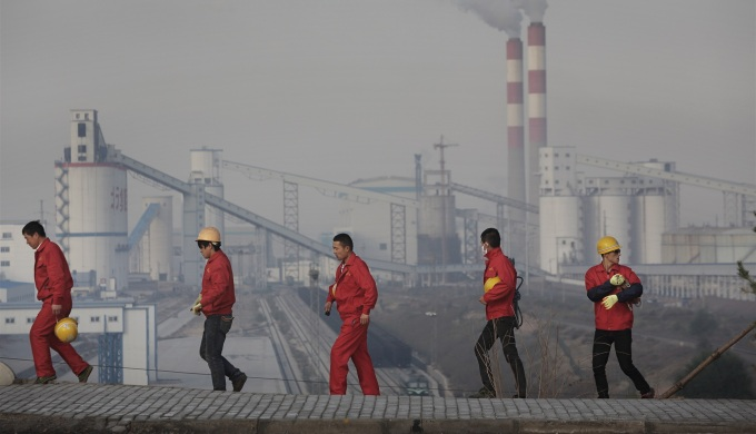 Global carbon dioxide emissions from fossil fuel combustion and cement production are set to grow another 2.5% in 2014 (image by Qui Bo/Greenpeace)