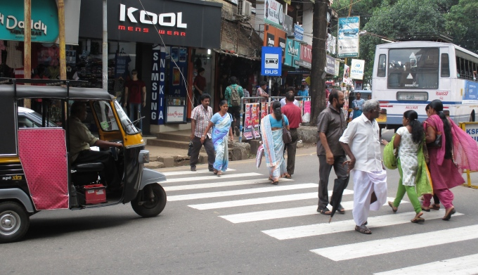 Pedestrians cross a busy road in Thrissur (Image by S. Gopikrishna Warrier)