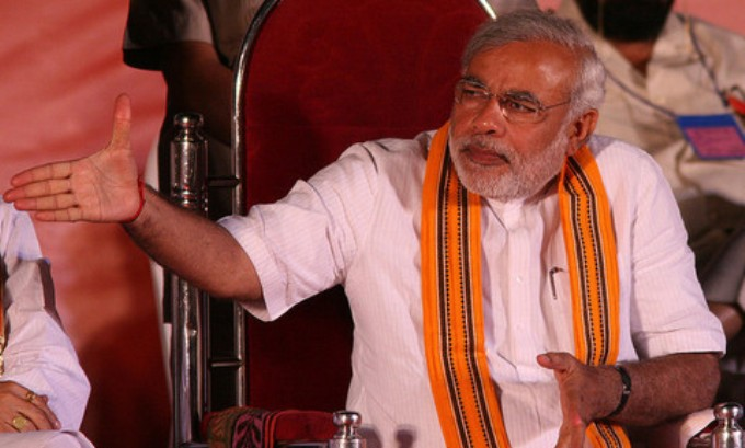India's Prime Minister Narendra Modi's energy policy aims for a greener energy mix but will remain heavily reliant on coal