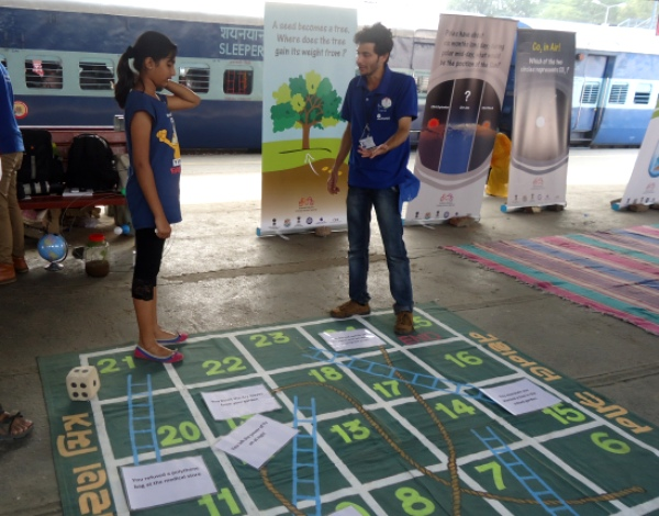 13-year-old Tehrim learning about climate change through a modified version of 'Snakes & Ladders' (Image by Juhi Chaudhary)