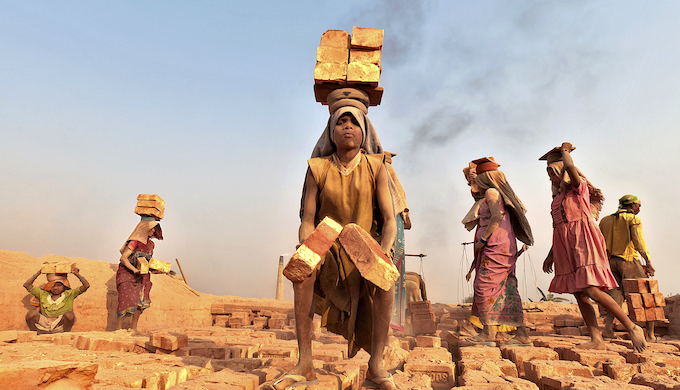 Women working in a brick kiln in India (Photo by International Labour Organization)