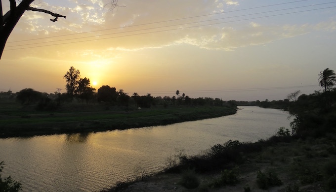 The Shipra flows into Ujjain at sunset.