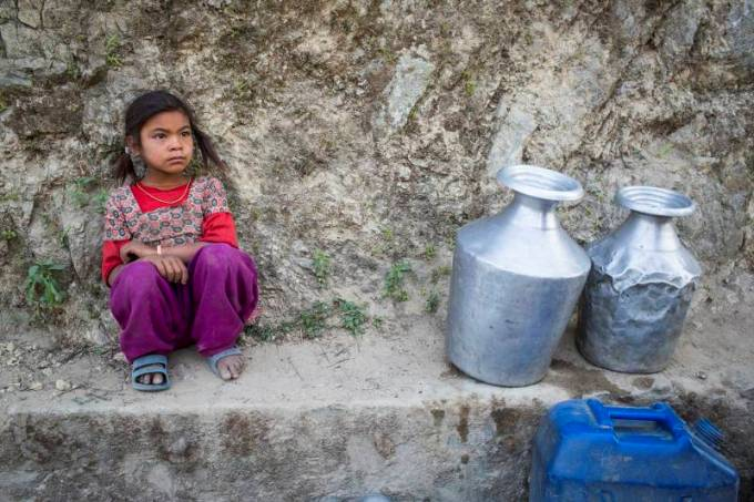 Bishnu Magar awaits her turn to fetch drinking water in Udayapur, Nepal. (Photo: Nabin Baral)