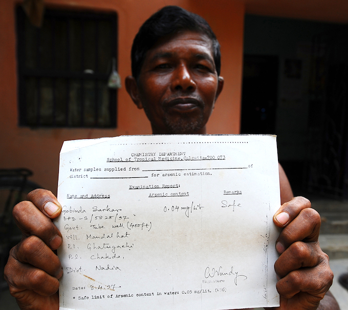 Gobindo Sarkar of Mandalhat village in Nadia district has been fighting the arsenic menace since the 1980s. He was one of the pioneers who set up the Arsenic Protirodh Committee (Combat Arsenic Committee). In 1997, when he took a sample of water from neighbourhood tubewell for testing in Kolkata, the expert said the arsenic concentration was within the safe limit set by WHO. But within days of getting this report, Sarkar fell ill, and doctors Kolkata Medical College diagnosed arsenic poisoning as the cause. Sixty years old now, Sarkar suffers from melanosis – his skin is broken and scarred. During daylight hours, he is unable to stay outdoors for any length of time. The committee he helped set up has been disbanded. He says it was under pressure from politicians who kept insisting that there was nothing wrong with the groundwater.