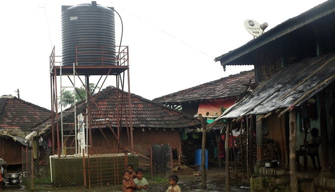 The overhead water tank and Skyhydrant water filtration unit at Bhojpada village. (Photo by Nidhi Jamwal)