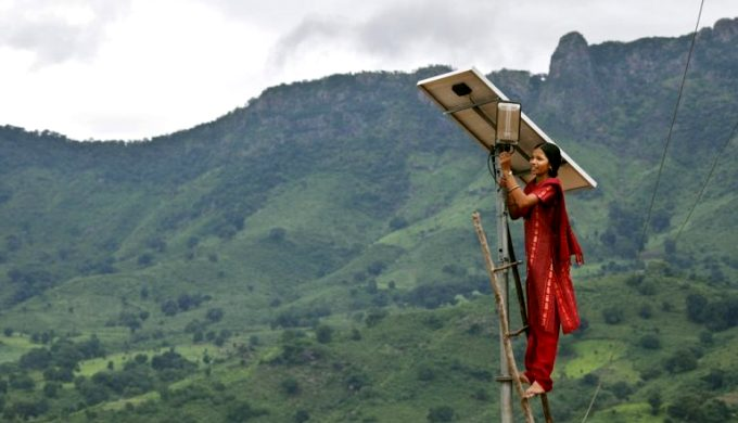 Meenakshi Dewan doing maintenance work on a solar street lighting in her village of Tinginaput, India [image by Abbie Trayler-Smith / Panos Pictures / Department for International Development]