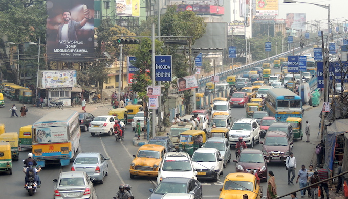 Diesel-run taxis, buses and trucks contribute substantially to Kolkata's air pollution. (Photo by Jayanta Basu)