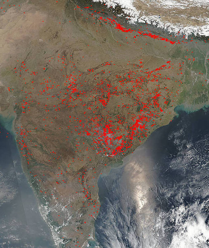 A satellite image of agricultural fires raging across India. (Photo by Jeff Schmaltz / NASA)