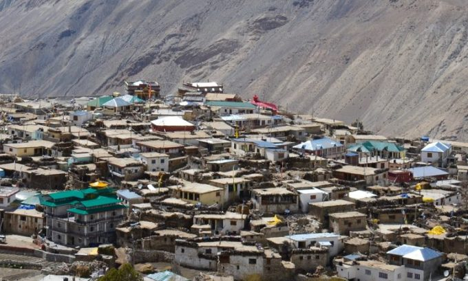 The traditional flat roofs are giving way to metal pent roofs in Nako as climate change affects precipitation [image by Manu Moudgil]