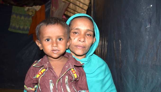 Rokeya Begum has fled to Bangladesh with her children from Bolirbazar in Maungdaw district of Rakhine state in Myanmar. She doesn't know if her husband is still alive (Photo by Zobaidur Rahman)