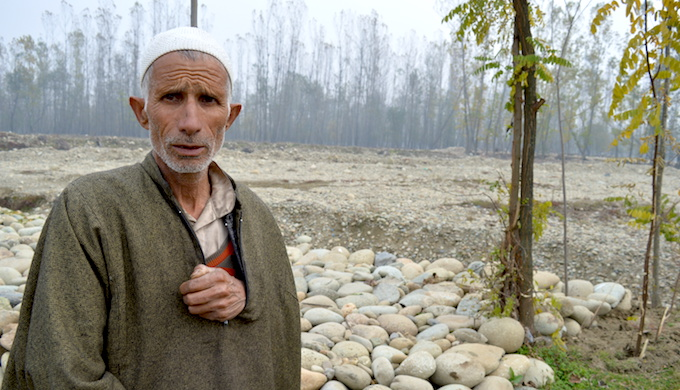 Mohammad Yousuf, a farmer of Kelam-Kulgam, was among thousands of farmers who lost their agricultural land during the 2014 floods (Photo by Athar Parvaiz)