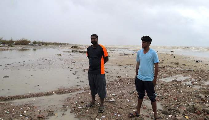 Destruction caused by recent cyclone has reinforced the resolve of fishermen Mathimurugan and Manikandan to go abroad again (Photo by Jency Samuel)