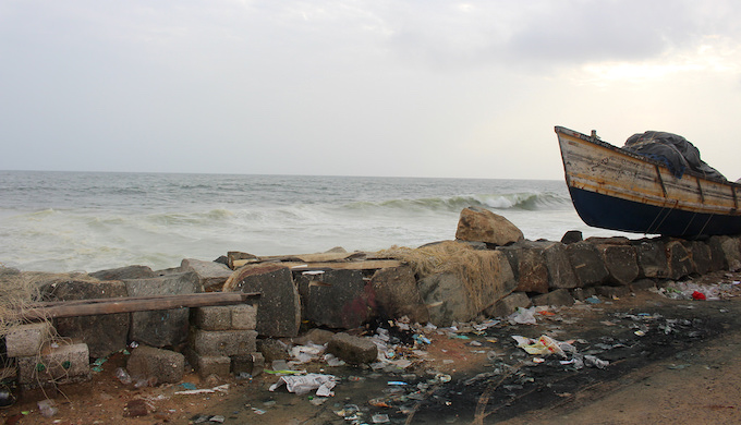 Poonthura is protected from the ocean by a seawall. Meant to stem erosion, seawalls of enormous granite blocks, which now line more than 60% of the coast in Kerala, actually contribute to erosion by preventing the natural restoration of sand and sediment (Photo by Mary-Rose Abraham)