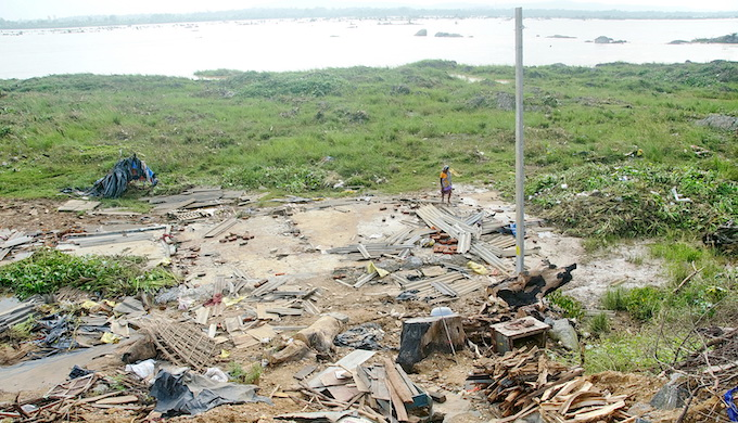 Fourteen houses of poor and internally displaced people on the Mahanadi riverbed were washed out after heavy rainfall (Photo by Ranjan Panda)