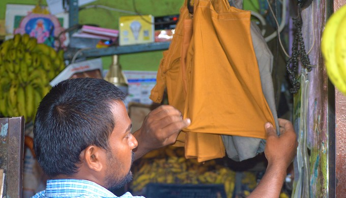 (1)Arun Kumar, a vegetable seller in Chennai, showing the cloth bags at his shop. He has stopped selling fruit in plastic carry bags since the inception of the ban on single-use plastic. Kumar said that he charges INR 10 (USD 14 cents) for each bag if some customer is not carrying his own bag. He said most customers carry their own bags and he hardly sells five to 10 bags every day (all photos by Athar Parvaiz)