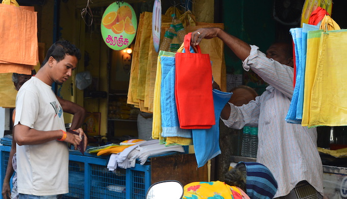 A shopkeeper selling reusable bags in a fish market in Chennai. An organiser of the market, Murugan, said that a lot of plastic bags were being used in fish market before the ban. But now, he said, plastic has completely vanished from the market