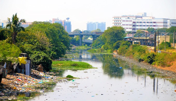Plastic refuse in Chennai's Koovum Canal, which used to serve as waterway for water transport from Chennai to Nelore in Andhra Pradesh. Government officials and common people in Chennai said that flooding of the city is often caused by blocking of drains because of plastic pollution