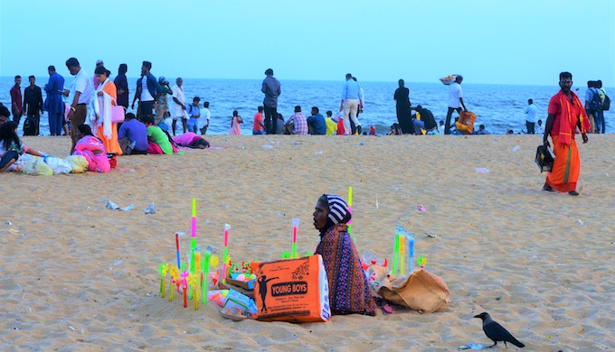 A woman selling plastic toys at Marina beach is using jute bags to carry them to the beach