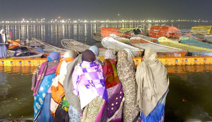 A group of women praying at the confluence of the Ganga and Yamuna in Prayagraj during the Kumbh Mela. Hindus consider the Ganga holy, and say it is inextricably linked with India's civilizational values (Photo by Soumya Sarkar)