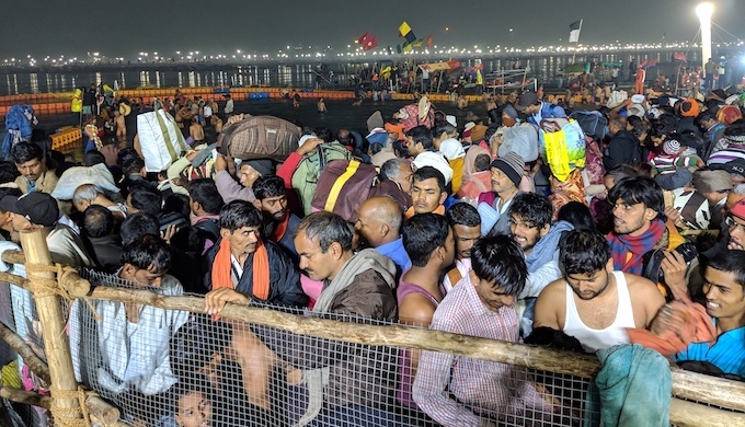 A press of pilgrims waiting their turn to take a holy dip at the confluence of the Ganga and Yamuna at the Kumbh Mela in Prayagraj (Photo by Soumya Sarkar)