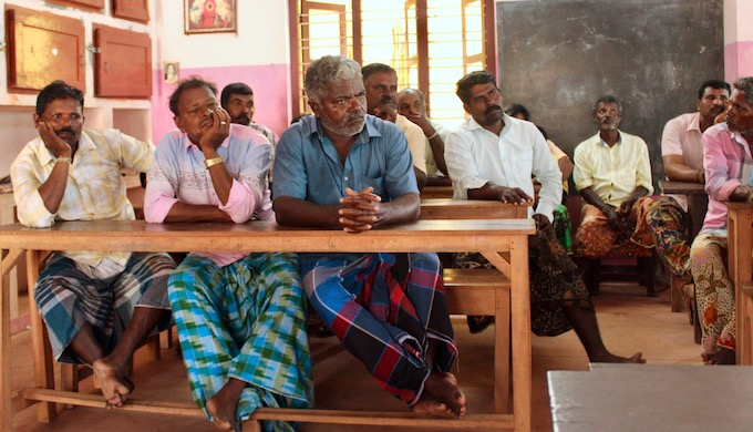 Fishers of Poonthura village close Thiruvananathapuram city gather at a local school for an informal meet to talk about developing communication tools for safe and sustainable artisanal fishing (Photo by MM Paniyll)