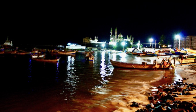 During the monsoon season, fishers from nearby villages reach Vizhinjam fishing harbour before daybreak for an early launch (Photo by MM Paniyll)