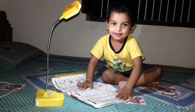 For poor households, solar lamps for lighting are a better option that polluting kerosene lanterns (Photo by Mohd Imran Khan)