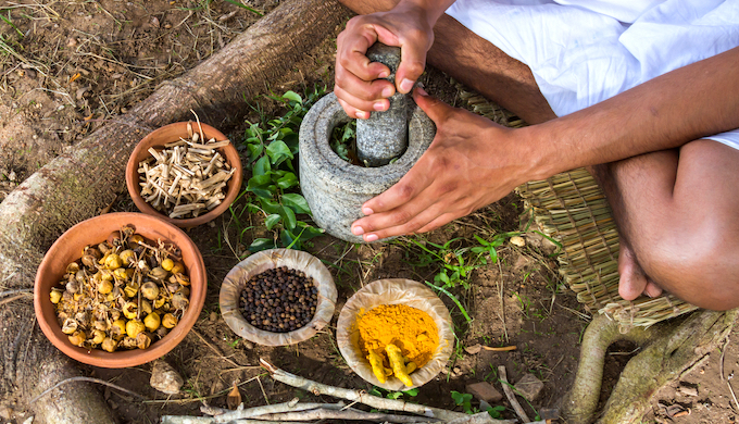 A Indian man preparing Ayurvedic medicine in the traditional manner (Photo by Nila Newsom)