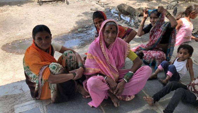 Jyoti Bai (centre) of Umarkheda village, a frail woman in her seventies, recounts her daily struggle to collect water (Photo by Joydeep Gupta)