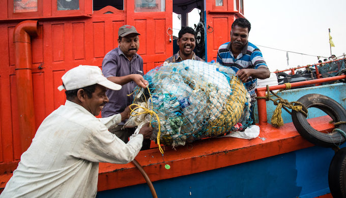 The crew of Holy Star with litter recovered from their nets at Sakthikulangara harbour in Kerala (Photo by Shailendra Yashwant)