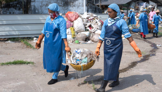 Clean Seas staff carry washed marine waste (Photo by Shailendra Yashwant)