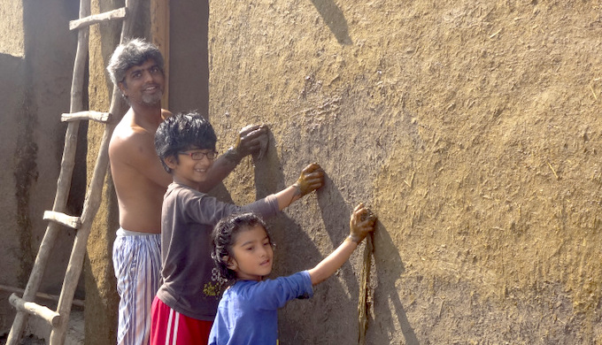 Plastering the walls of the house with cow dung helps to keep it cool (Photo by Shantanu Mundhada)