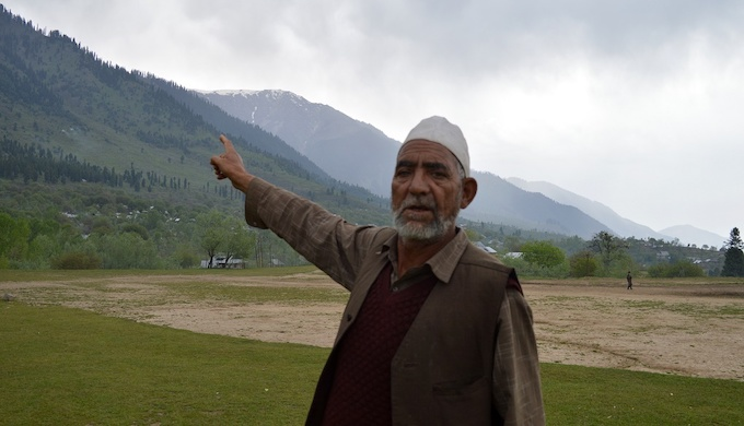 A Kashmiri man near a Budgam forest shows the degradation caused to forests over the past few decades (Photo by Athar Parvaiz)