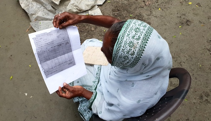 Sabita Biswas shows her land documents (Photo by Chandrani Sinha)