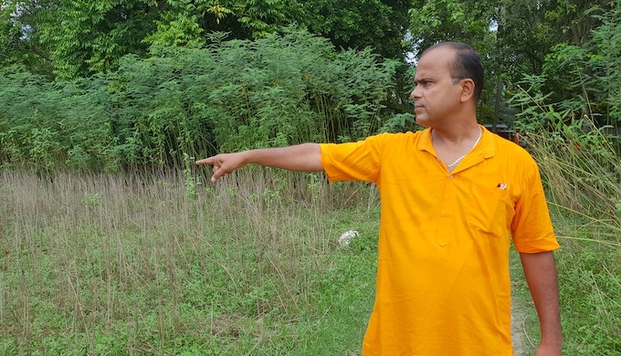 Santanu Sanyal showing damaged Jute fields in Morigaon district, Assam (Photo by Chandrani Sinha)